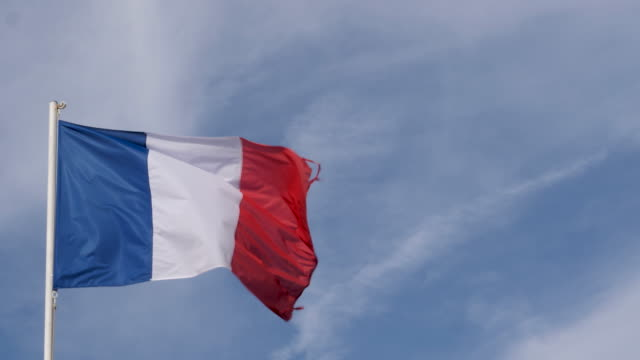 4k close up slow motion of france national flag flying proudly in the wind on a warm beautiful bright summer day. with copy space - french flag stock videos & royalty-free footage