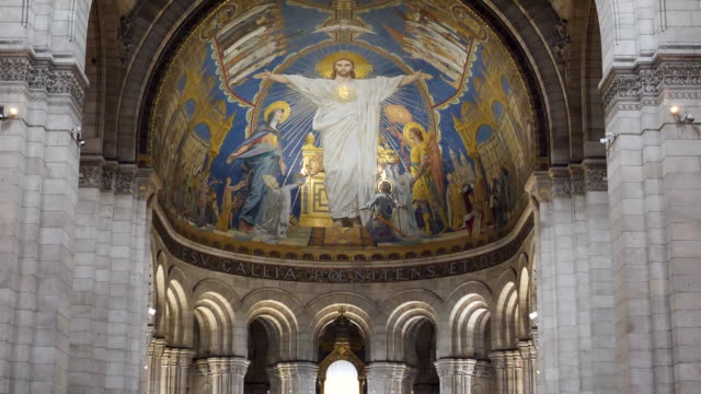 4k close up the basilica of the sacred heart of paris interior focusing on the fresco of jesus christ. popular famous place to visit for tourists in paris and important historical religious landmark - イエス キリスト点の映像素材/bロール
