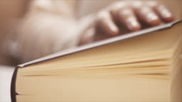 4k Close-Up Of A Hand Closing A Book - Slow Motion - Literature, Reading