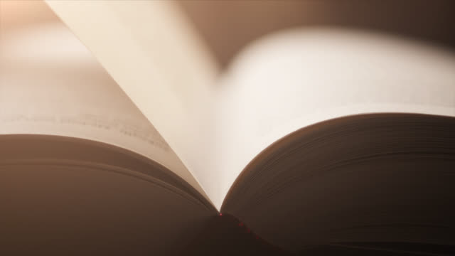 4k close-up of a hand turning a page - slow motion - book, literature, reading - dreamlike stock videos & royalty-free footage