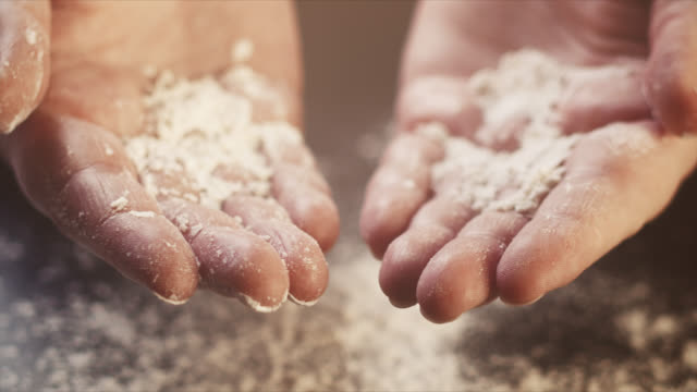 4k close-up of hands covered with flour - slow motion - baking, working, preparation - talcum powder stock videos & royalty-free footage