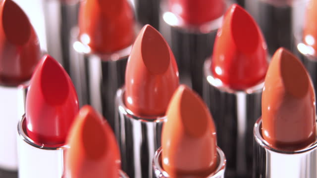 4k close-up of turning of lipsticks collection. - make up stock videos and b-roll footage