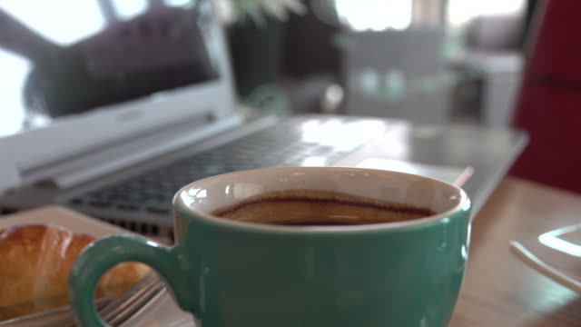 4k: Coffee cup with laptop on the desk