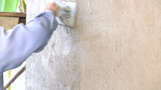 4k, construction worker plaster cement wall - plaster stock videos and b-roll footage