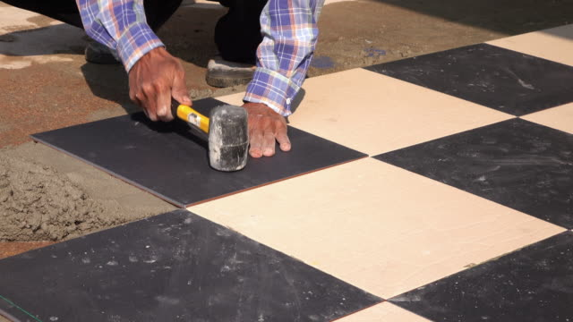 4k, construction worker tiling ceramic tiles floor