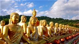 4k crane shot ;Public places, 1,250 Buddha statue, history of atmagha puja memorial buddhist park, Nakhon Nayok, Thailand