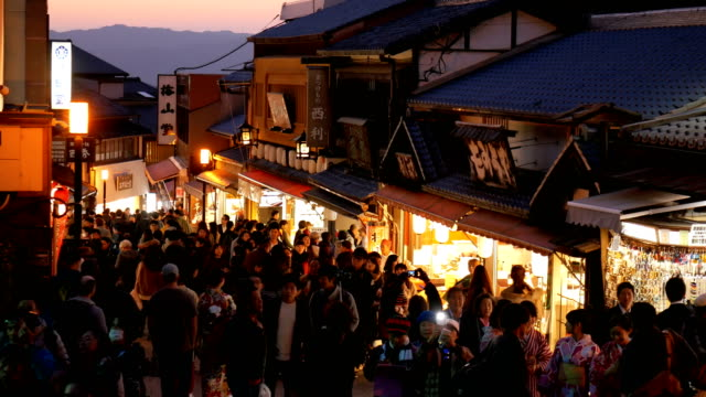 4k crowd of people on walking street at kiyomizu temple kyoto, japan - kyoto temple stock videos and b-roll footage