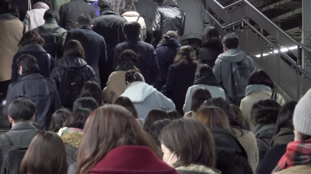 4k: crowded people in the mass public transportation japan - rail transportation stock videos & royalty-free footage