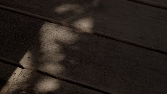 4k dci footage of shadow on a wooden floor - flooring stock videos & royalty-free footage