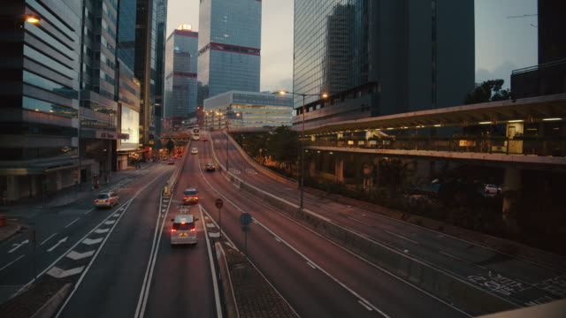 4k dci resolution time lapse of traffic road ,modern business building  at central district at hong kong city china .skyline,cityscape, sunset - road sign stock videos & royalty-free footage