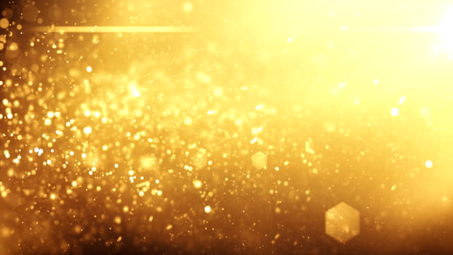 4k defocused particles background (gold) - loop - gold coloured stock videos & royalty-free footage