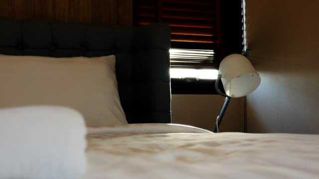4k: dolly shot movement of bedroom - bed furniture stock videos & royalty-free footage
