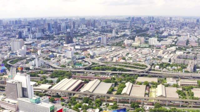 4k drone aerial view of highway and overpass ntersection road in capital bangkok thailand city structure of architecture and transportation concept - road map stock videos & royalty-free footage