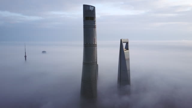4k drone footage : shanghai financial district in fog - east china stock videos & royalty-free footage