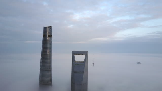 4k drone footage : shanghai financial district in fog - china east asia stock videos & royalty-free footage