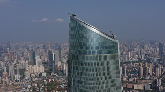 4k drone footage : wuhan landmark wuhan center tower - asia stock videos & royalty-free footage