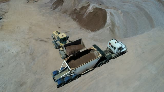4k drone gravel quarry - construction vehicle stock videos and b-roll footage