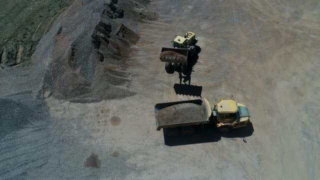 4k drone gravel quarry - mining stock videos & royalty-free footage