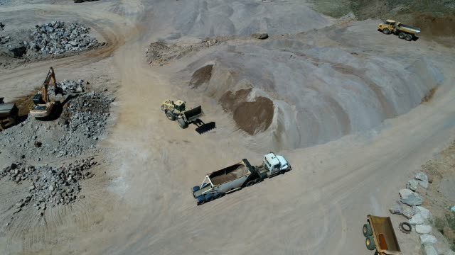 4k drone gravel quarry - quadrokopter stock-videos und b-roll-filmmaterial