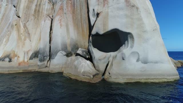 4k drone rock island ocean - brightly lit点の映像素材/bロール