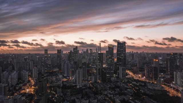 4k drone time-lapse footage : magnificent sunrise glow over shanghai city - dramatic sky stock videos & royalty-free footage
