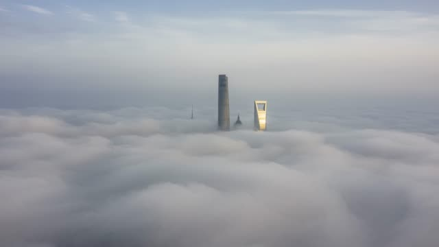 4k drone time-lapse footage : shanghai financial district in fog - shanghai tower stock videos & royalty-free footage