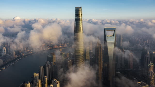 4k drone time-lapse footage : shanghai skyline at typhoon season - shanghai tower stock videos & royalty-free footage
