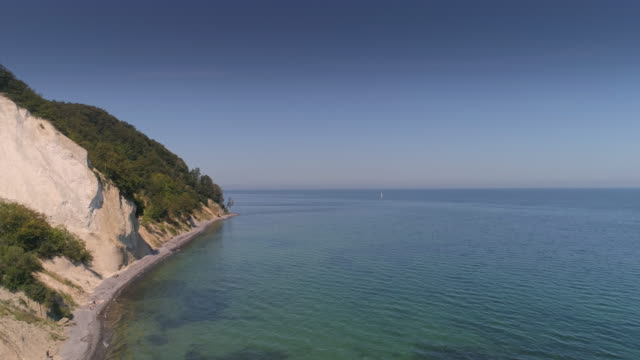 4k drone view of møns (moen) klint in denmark on a summer day - cliff stock videos & royalty-free footage