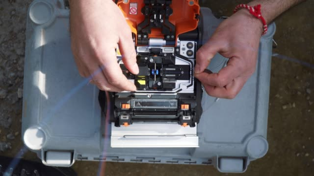 4k Fiber Optics Machine, Splicing, Internet, Connection, IT technologies, Extreme Close-Up of an IT Technician Working, Service, Engineering, Network,