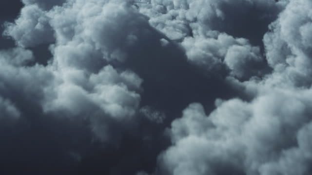 4k flying over storm clouds background - loopable - climate change, meteorology, weather forecasting - flying stock videos & royalty-free footage