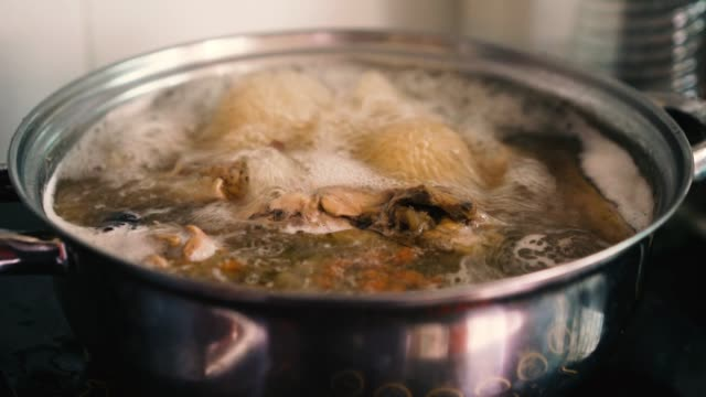 4k footage chicken soup - broth stock videos & royalty-free footage