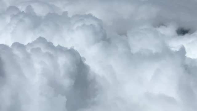 4k footage from an aircraft window - flying through dense clouds - aircraft carrier stock videos & royalty-free footage