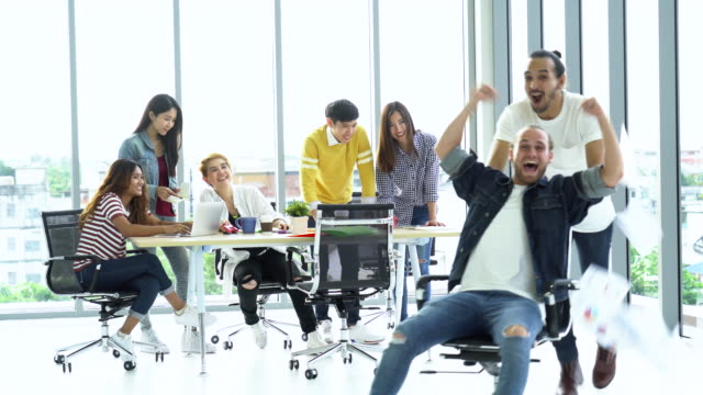 4k footage Group of Asian and Multiethnic Business people with casual suit moving up chair and throwing paper with happy action in the modern workplace, people business group concept