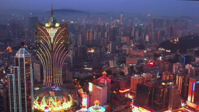 4k footage of aerial view of macau over the city during night time. travel destination and tourist attractions - macao stock videos & royalty-free footage
