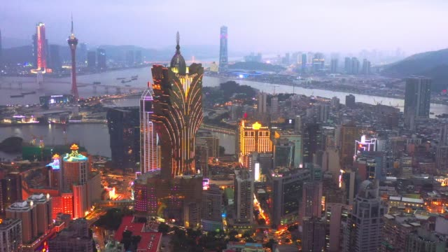 4k footage of aerial view of macau over the city during night time. travel destination and tourist attractions - macao flag stock videos & royalty-free footage