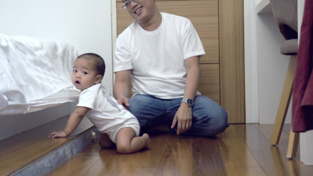 4k footage of asian naughty child pulling coverlet of bed and stubborn father in the room at modern loft house, family and lifestyle concept - genderblend stock videos & royalty-free footage