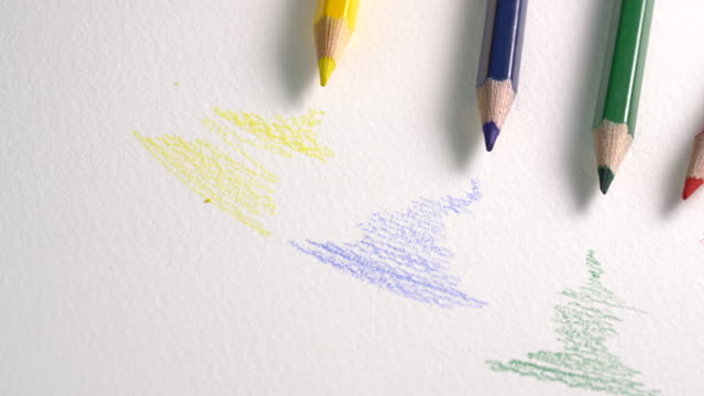 4k footage of color pencil on white background - graphite stock videos & royalty-free footage