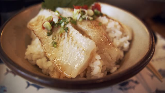4k footage of engawa don japanese fish with rice below it - food state stock videos & royalty-free footage