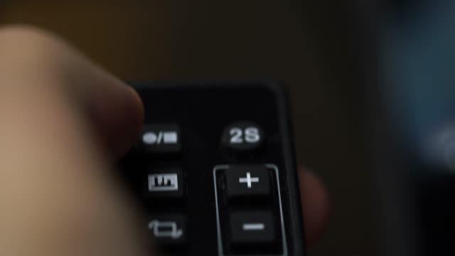 4k footage of man hand use Camera wireless remote