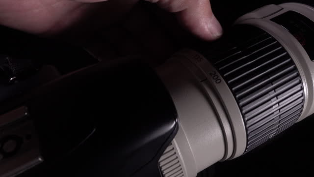 4k Footage of Man hand Zooming Lens
