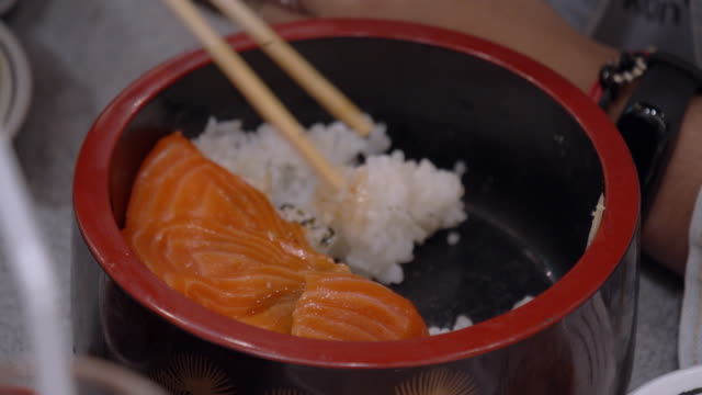4k footage of salmon don .steamed rice with salmon sashimi, japanese traditional food - donburi stock videos and b-roll footage