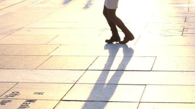 4k footage scene closeup legs of woman dancing step at freedom plaza, pennsylvania, washington, d.c., usa,  american style and music tradition concept - tango ballo video stock e b–roll