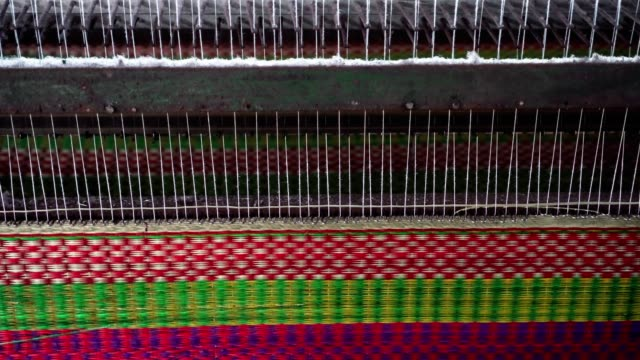 4k footage scene closeup of mat weaving machine the traditional vietnam mats in the old traditional village at dinh yen, dong thap, vietnam, tradition and manufacture concept - woven stock videos & royalty-free footage