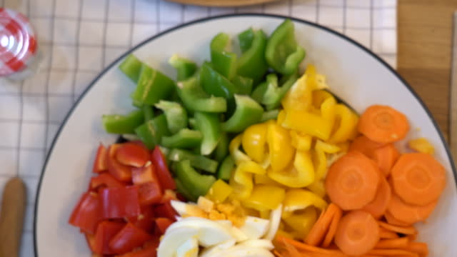 4k footage scene closeup top view ingredient of salad dish in the kitchen for preparing and cooking food, healthy and lifestyle concept