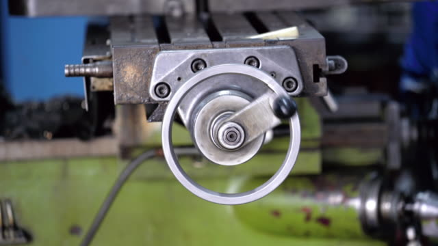 4k footage scene closeup wheel spindle working of lathes machine in metalworking factory, lathe metal working industry concept - machine part stock videos & royalty-free footage