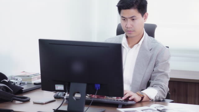 4k footage scene of asian businessman working with computer in office - job listing stock videos and b-roll footage