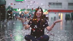 4k footage scene of attractive Asian woman celebrating and throwing with confetti in the room, Celebration with happy new year and Party concept