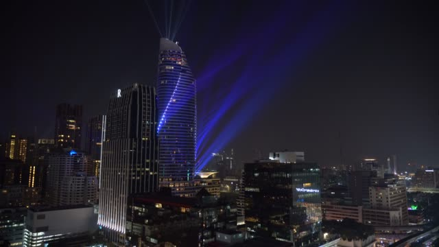 4k footage scene of bangkok cityscape with amazing light show on modern building and traffic road intersection in rush hour at night time in bangkok, transportation with cityscape concept - awards ceremony stock videos & royalty-free footage