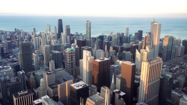 4k footage scene of chicago skyline panorama with blue sky and cloud at beautiful sunset time in chicago, illinois, united states, landscape and modern architecture concept - chicago illinois stock videos & royalty-free footage