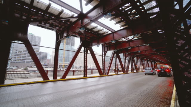 4k footage scene of chicago street bridge with traffic among modern buildings of downtown chicago at michigan avenue in chicago, illinois, united states, business and modern transportation concept - michigan avenue bridge stock videos and b-roll footage